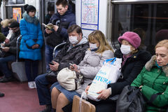 People in the subway in gauze bandages protected against swine flu Stock Photos