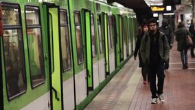 People on subway platform go into arrived train. People on subway platform train arrived, German stock footage