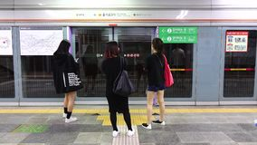 People at the subway station in Seoul, Korea. People waiting for the train at the Euljiro 3-ga subway station in Seoul, Korea stock video