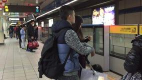 People at the subway station in Taipei, Taiwan. People waiting for the train at the subway station in Taipei, Taiwan stock video