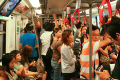 People in subway train. Bangkok Mass Transit System, Thailand Stock Photo