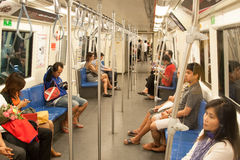 People in subway train (empty wagon). Bangkok Mass Transit System, Thailand Stock Photography