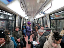 People in subway train wagon interior Stock Photos