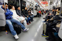 People in the subway train at night in Osaka, Japan Stock Photography