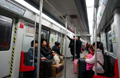 Inside the subway train. People in the subway train in Wuhan city of China,this subway line is the first one in the city.Taken on Jan.23,2013 Stock Photography