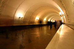 People into the subway tunnel Stock Images