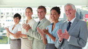 People in suit applauding in line Royalty Free Stock Photography
