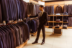 People in suit shop Royalty Free Stock Photography