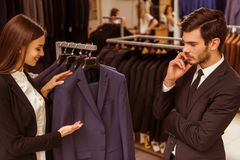 People in suit shop Royalty Free Stock Photo