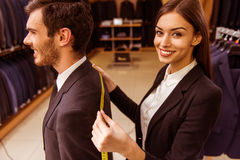 People in suit shop Stock Photos