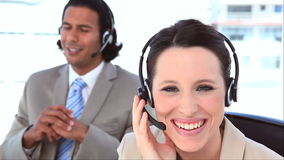 People in suit using headsets Royalty Free Stock Image