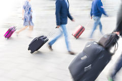 People with suitcases Stock Photo