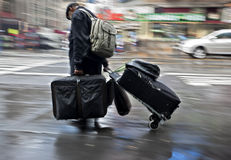 People with suitcases on a city street Stock Photo