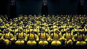 People in suits of bacteriological protection sit in the cinema waiting for the movie. People in yellow protective suits