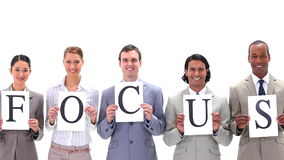 People in suits holding boards with the word FOCUS Stock Photos
