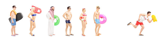 People with summer objects waiting in line Royalty Free Stock Photography