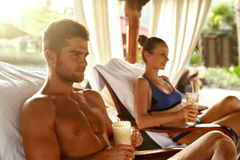 People Summer Vacation. Friends Relaxing Outdoors At Spa Resort Royalty Free Stock Photo
