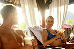 People Summer Vacation. Friends Relaxing Outdoors At Spa Resort Stock Images