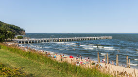 People sunbath on a beach. In Orlowo, district of Gdynia, former fishermen village founded in 1826. Main attractions are maritime cliffs and the pier at 180m stock photo