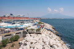 People sunbath at the pool in port of Naples Stock Photos