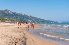People sunbathe on the Banana beach, Zakynthos, Greece Royalty Free Stock Photos