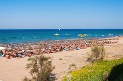 People sunbathe on the Banana beach, Zakynthos, Greece Royalty Free Stock Image