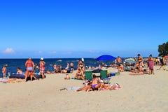 People sunbathe on the sandy coast of the Baltic Sea Royalty Free Stock Photo