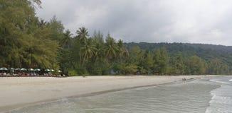 People sunbathe and swim at the beach paradise of coconut island. Ko Kut,Thailand- February 25,2018: People sunbathe and swim at the beach paradise of coconut Stock Photography