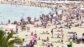 People sunbathing at Barceloneta beach Stock Image