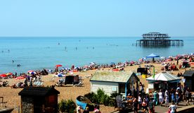 People sunbathing on beach in Brighton stock photo