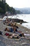 People sunbathing on beach on 30 July 2016 in Desenzano del Garda, Italy. DESENZANO DEL GARDA, ITALY - JULY 30: People sunbathing on beach on 30 July 2016 in stock images