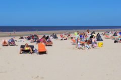 Sunbathing people beach, Netherlands Royalty Free Stock Images