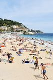 People sunbathing on the beach in Nice, France Royalty Free Stock Images