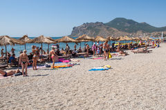 People sunbathing on the beach Stock Image