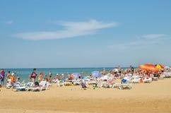 People sunbathing at the beach Stock Photo