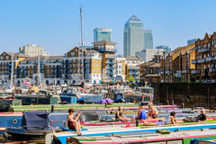 People sunbathing on the boats moored at Limehouse Basin Royalty Free Stock Photo