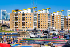People sunbathing on the boats moored at Limehouse Basin Stock Images