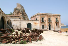 People sunbathing in front of Tonnara at Scopello on Sicily Stock Images