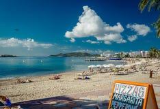 People sunbathing on a Ibiza Stock Photography