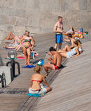 People sunbathing at Olive Beach Royalty Free Stock Photo