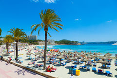People sunbathing at Paguera Beach, Majorca, Spain Royalty Free Stock Photos