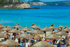 People sunbathing at Paguera Beach, Majorca, Spain Stock Photography