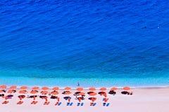 People sunbathing on a paradise Apella beach. At island karpathos greece. summer time Stock Photography