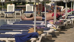 People sunbathing by the pool in the resort of Golden Sands, Bulgaria. Varna - the sea capital of Bulgaria, a center of shipping and tourism. Today it is the stock footage