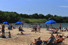 People Sunbathing and relaxing on the beach royalty free stock photo