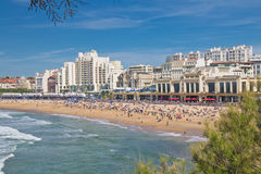 People sunbathing in scenic seascape of atlantic ocean in blue sky in surf spot destination of biarritz, france Royalty Free Stock Photography