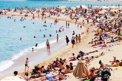 People sunbathing on sunny summer beach Stock Photography
