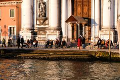 People sunbathing in winter in Venice Royalty Free Stock Photography