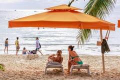 People on sunbed joying Boracay beach. BORACAY ISLAND, PHILIPPINES - November 17, 2017 : People on sunbed joying Boracay beach Royalty Free Stock Image
