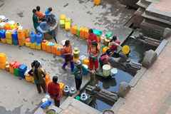 People at Sunken Manga Hiti with water containers for household use Royalty Free Stock Photos